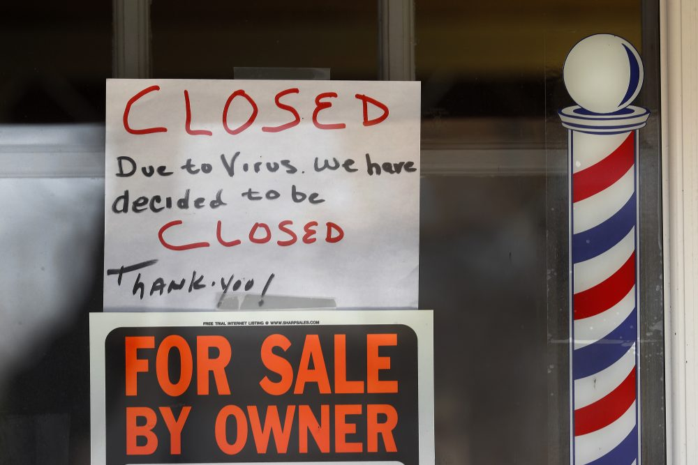 """For Sale By Owner"" and ""Closed Due to Virus"" signs are displayed in the window of Images On Mack in Grosse Pointe Woods, Mich., on April 2. The coronavirus outbreak has triggered a stunning collapse in the U.S. workforce with 10 million people losing their jobs in the past two weeks and economists warn unemployment could reach levels not seen since the Depression, as the economic damage from the crisis piles up around the world."