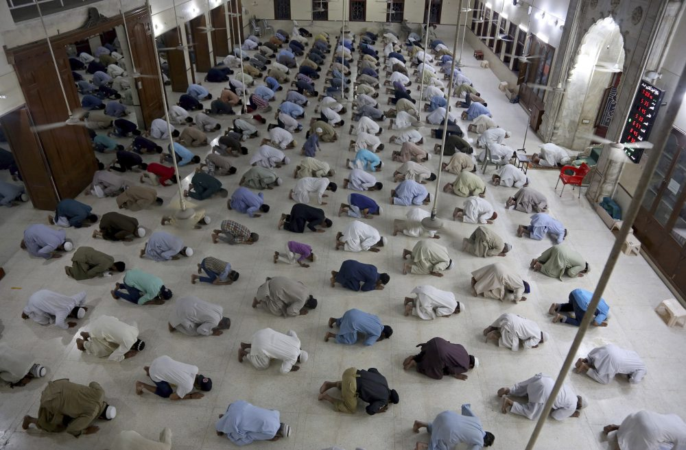 People attend evening prayers while maintaining a level of social distancing to help avoid the spread of the coronavirus, at a mosque in Karachi, Pakistan, on Sunday. In Maine, Muslims are finding creative ways to observe both their faith and the public health guidelines related to coronavirus during Ramadan.