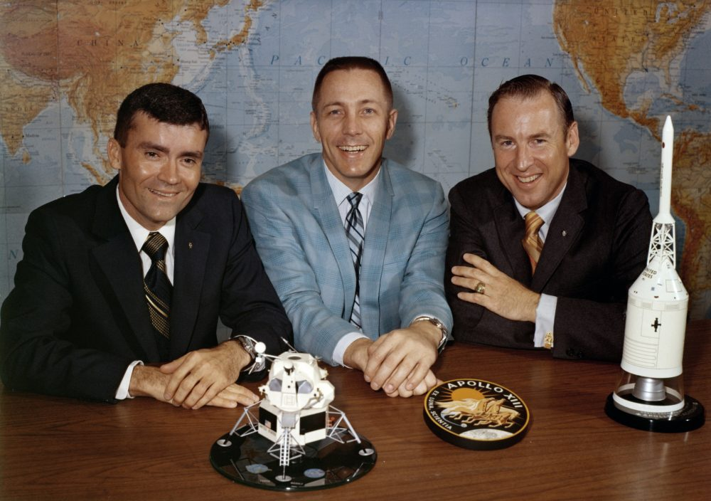 Apollo 13 astronauts, from left, Fred Haise, Jack Swigert and Jim Lovell gather for a photo April 10, 1970, on the day before launch.