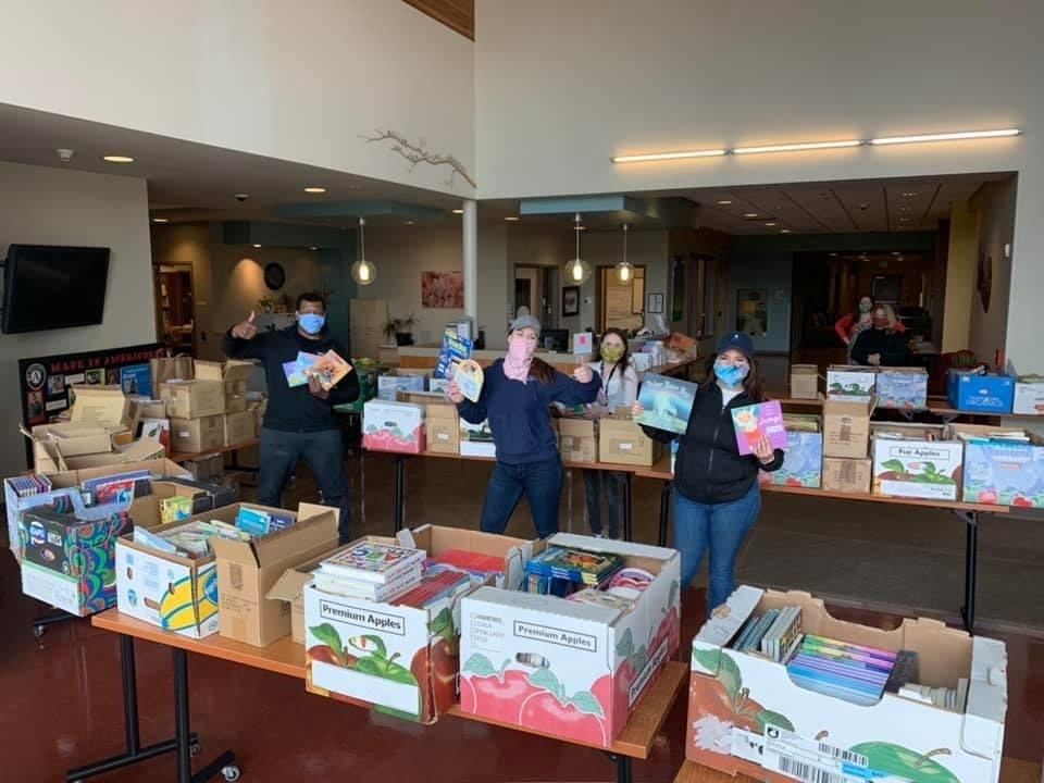 KV Connect members assist with delivery of children's books to Educare Central Maine in Waterville.