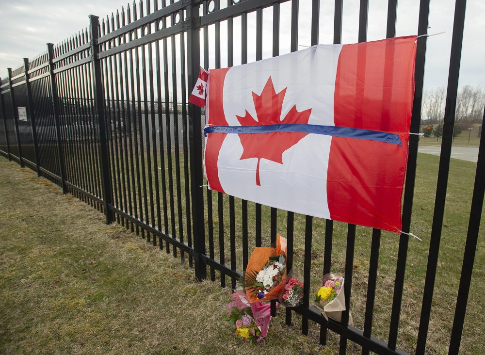 A tribute is displayed Monday at the Royal Canadian Mounted Police headquarters in Dartmouth, Nova Scotia, following a weekend shooting rampage by a gunman, disguised as a police officer, that killed at least 23 people including an RCMP constable.
