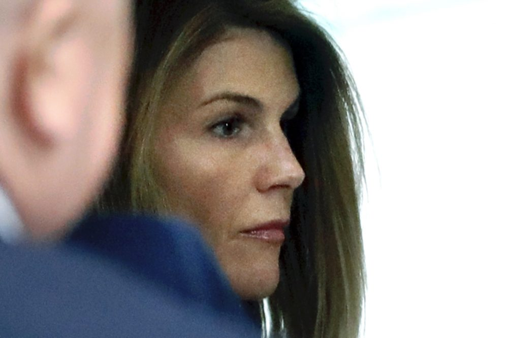 Lori Loughlin enters federal court in Boston Aug. 27 for a hearing in a nationwide college admissions bribery scandal.