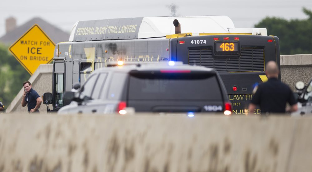 A DART bus is investigated after a gunman held the driver hostage and fired shots inside the bus while being chased by police on Sunday in Garland, Texas. The gunman was shot by officers and transported to the hospital, where he was pronounced dead. Two officers were shot and transported to the hospital with non-life threading injuries.