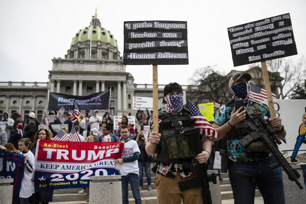 Protesters demonstrate Monday at the state Capitol in Harrisburg, Pa., demanding that Gov. Tom Wolf reopen Pennsylvania's economy even as new social-distancing mandates took effect at stores and other commercial buildings.