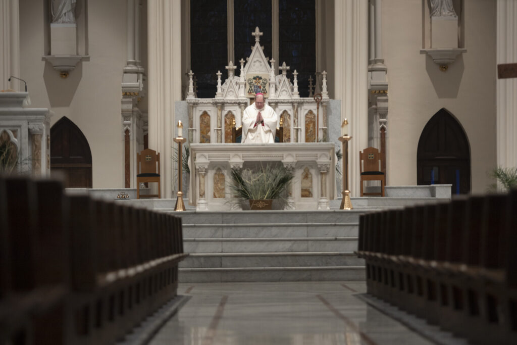 Bishop Robert Deeley,  Bishop of the Roman Catholic Diocese of Portland, delivers Holy Thursday Mass at Cathedral of the Immaculate Conception in April. Starting June 1, Maine parishes will begin offering indoor Masses, with restrictions.