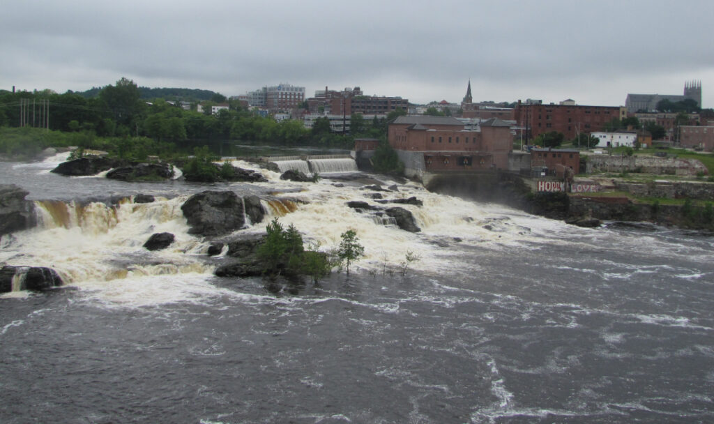 The Great Falls in Lewiston-Auburn only run for a few months out of the year. This overhead shot provides a view of these falls with the city of Lewiston as a backdrop.