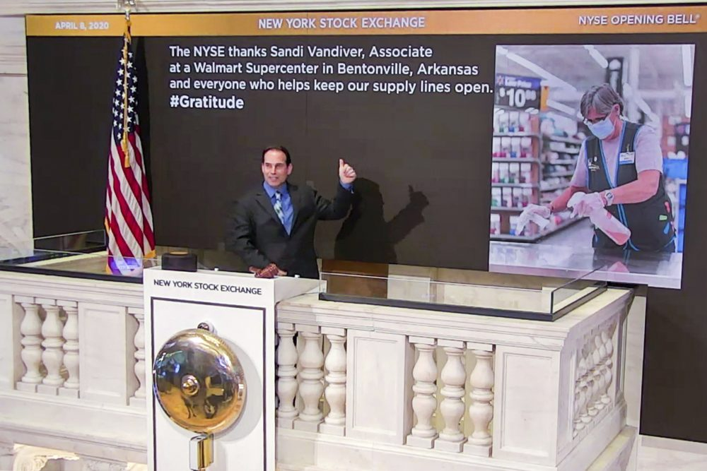 Kevin McSpedon, assistant chief electrician, rings the opening bell at the New York Stock Exchange, recognizing Sandi Vandiver, associate at a Walmart Supercenter in Bentonville, Arkansas, on Wednesday.