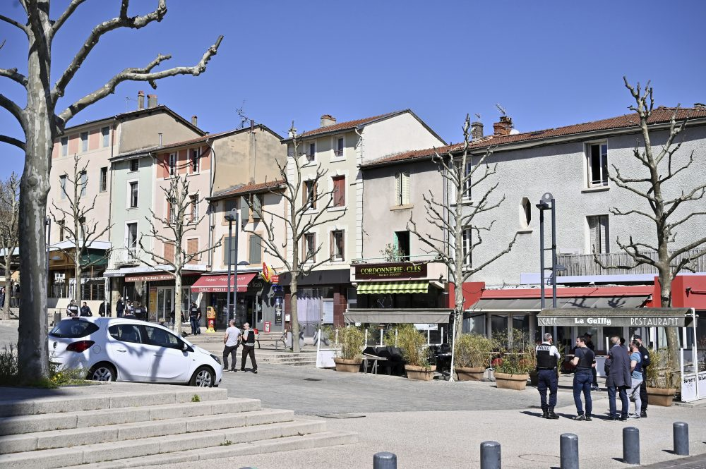Police officers patrol after a man wielding a knife attacked residents venturing out to shop in the town under lockdown, Saturday  in Romans-sur-Isere, southern France. The alleged attacker was arrested by police nearby, shortly after the attack.