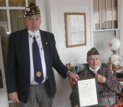 Raymond N. Soucy, 95, of Madison, left, was presented with a certificate from the American Legion National Headquarters for his 75 years of continuous membership with Tardiff-Belanger Post 39, Madison. H. Ralph Withee, past commander of Post 39 Madison, presented the certificate to Soucy on March 15.