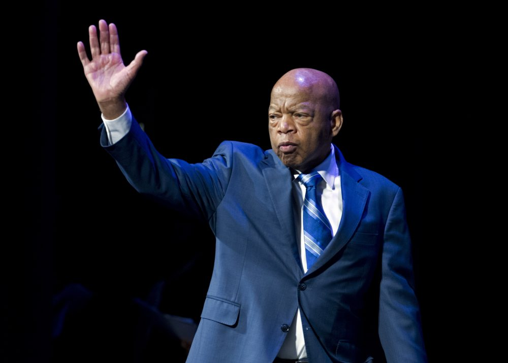 FILE- In this Jan. 3, 2019, file photo, Rep. John Lewis, D-Ga., waves to the audience during swearing-in ceremony of Congressional Black Caucus members of the 116th Congress in Washington. The NAACP honored Lewis for his Congressional service and long history as a civil rights activist.