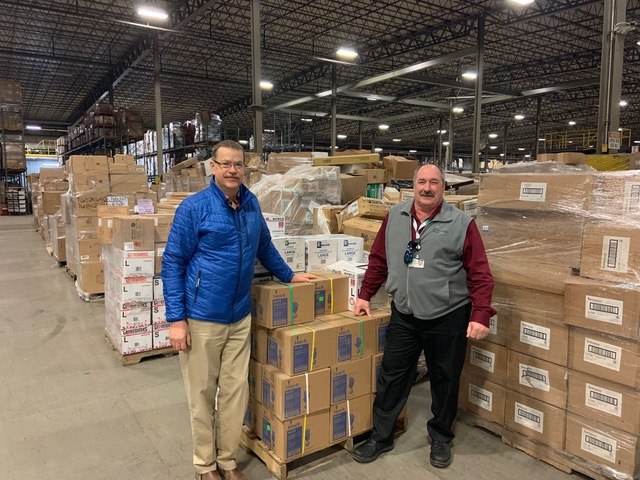 John Marden, left, with Joe Theriault, director of the regional supply chain for Northern Light Inland Hospital, with the recent delivery to Good Shepherd Food Bank.