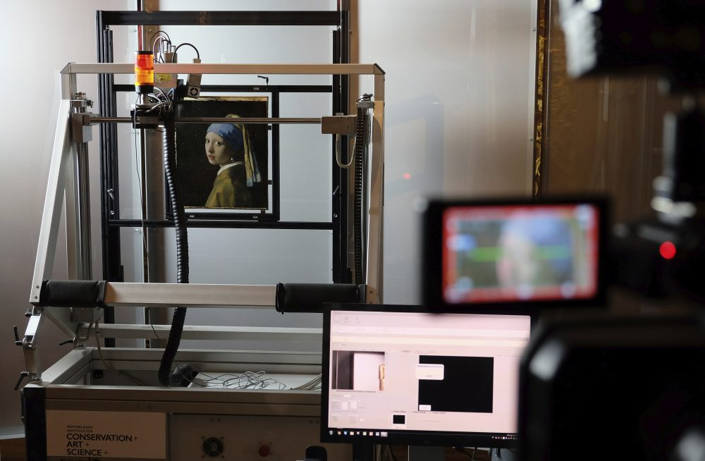 """In this file photo dated Monday, Feb. 26, 2018, a macro XRF scanner is used to study in minute detail the surface of Johannes Vermeer's 17th century masterpiece """"Girl with a Pearl Earring"""", at the Mauritshuis museum in The Hague, Netherlands."""