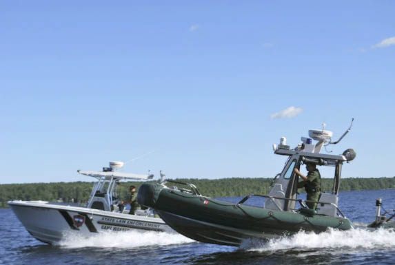 "Maine game wardens go out in patrol boats in one of the first episodes of ""North Woods Law."" The show now focuses on New Hampshire's wardens."