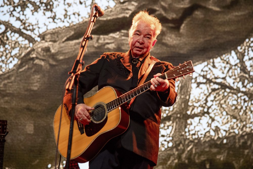 John Prine, shown performing in June 2019 at the Bonnaroo Music and Arts Festival in Manchester, Tenn., died Tuesday after being treated for COVID-19.