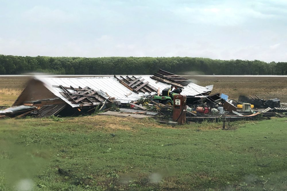 Strong storms pound parts of the Deep South, including this house and shed in Yazoo County, Miss., Sunday. Winds damaged buildings and toppled trees throughout Louisiana and Mississippi as they advance to Tennessee and Alabama.