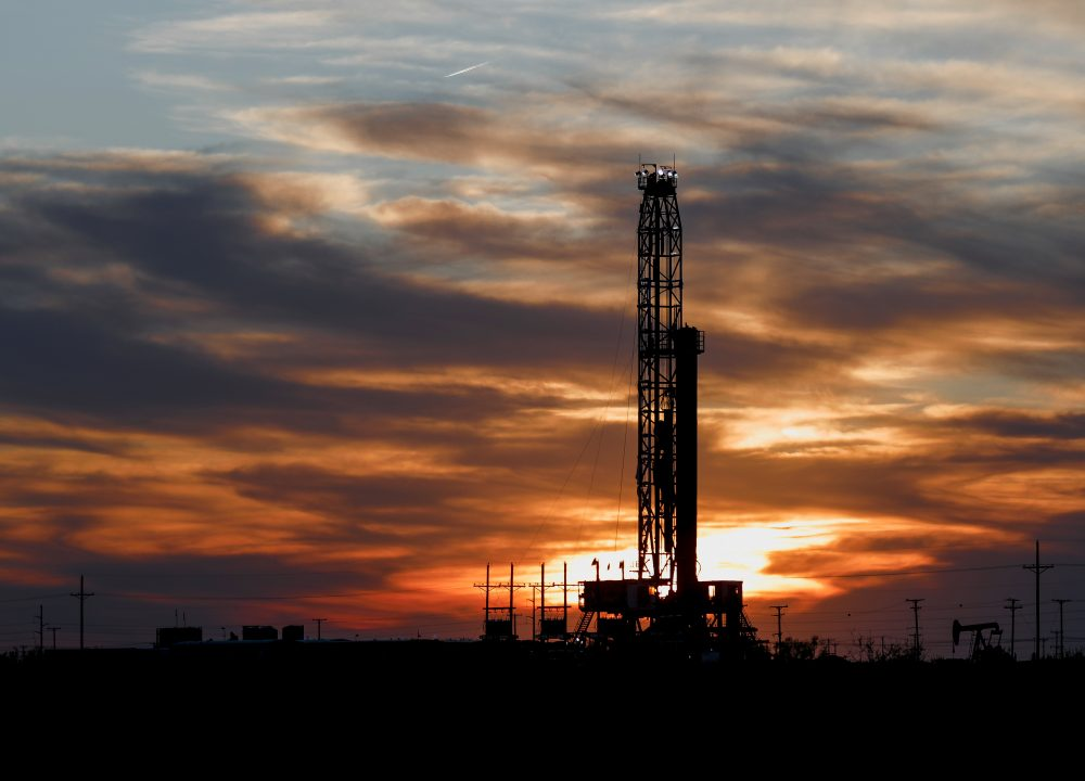 An oil rig stands against the setting sun in Midland, Texas on Friday, April 17.