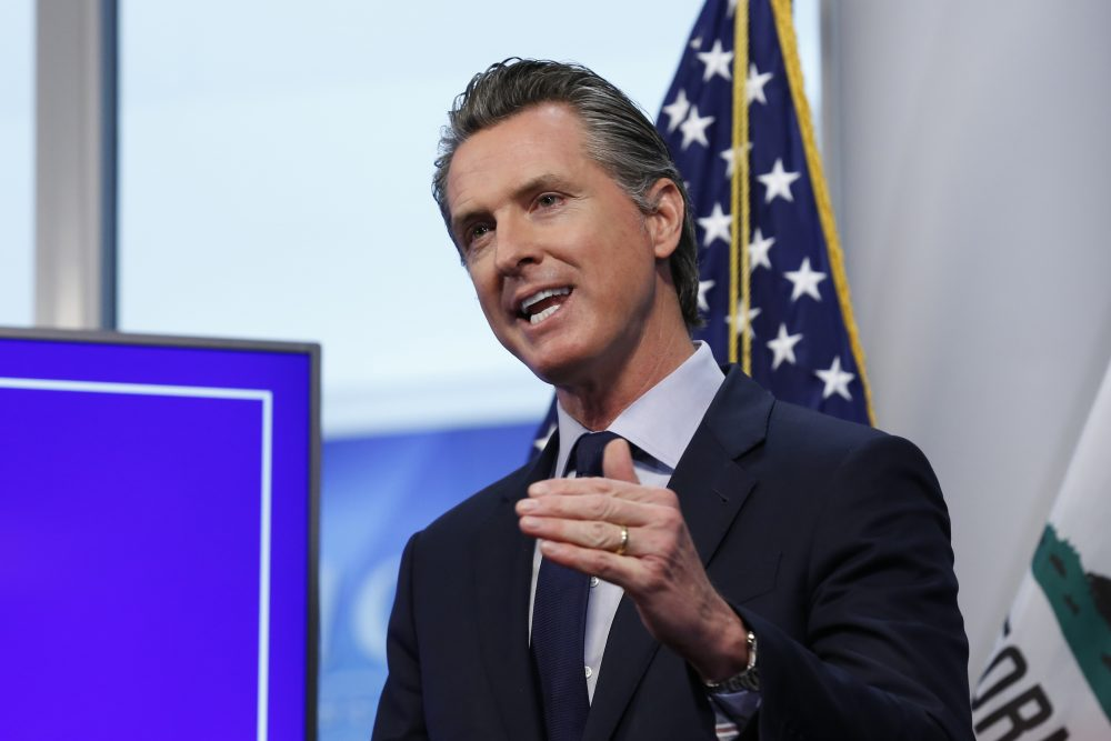 California Gov. Gavin Newsom discusses an outline for what it will take to lift coronavirus restrictions during a news conference Tuesday at the Governor's Office of Emergency Services in Rancho Cordova.