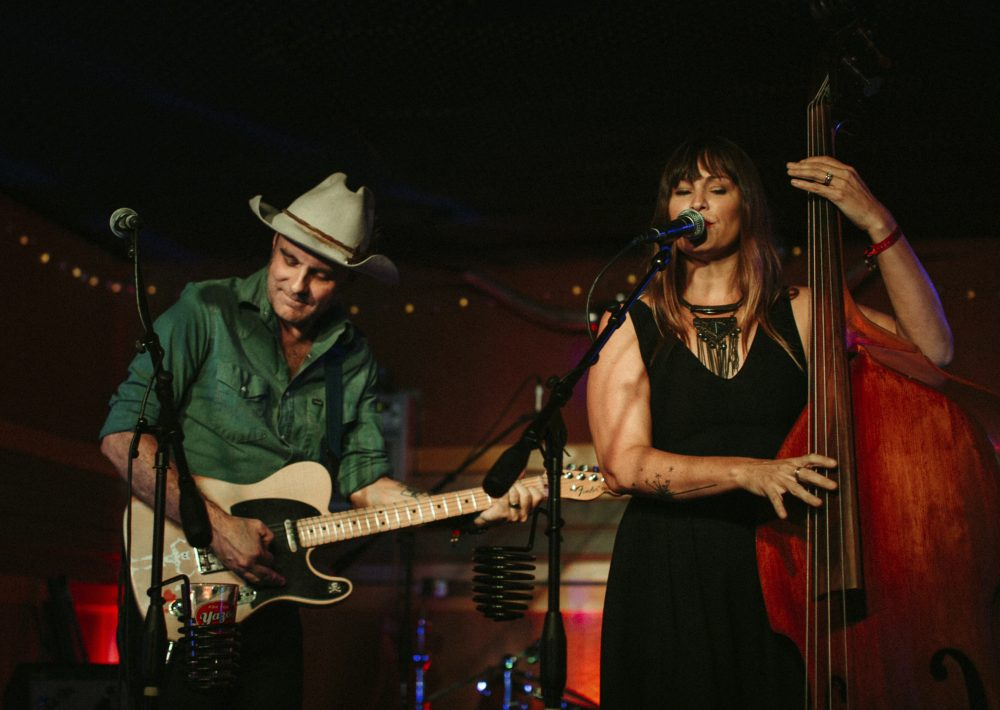 In this September 2019 photo, Doug and Telisha Williams, married musicians who perform together as the Wild Ponies, perform at Dee's Country Cocktail Lounge in Nashville, Tenn.