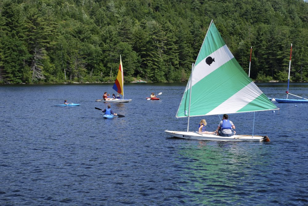 Campers go boating and kayaking at Forest Lake Camp in Warrensburg, N.Y., during a previous season.