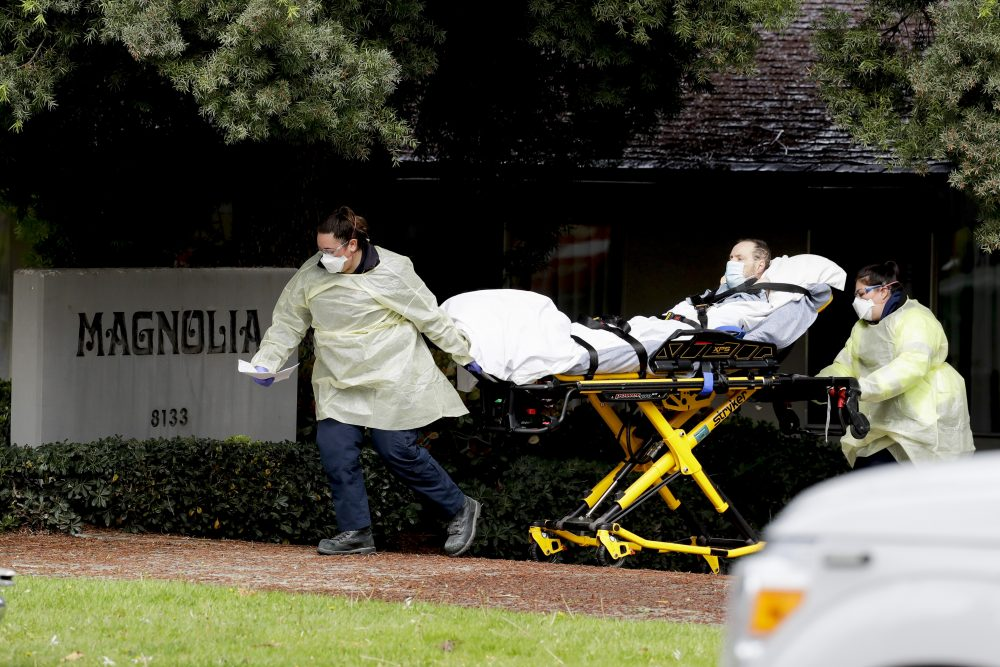 A patient is evacuated from the Magnolia Rehabilitation and Nursing Center in Riverside, Calif., on Wednesday. Experts say nursing home deaths may keep climbing because of chronic staffing shortages.
