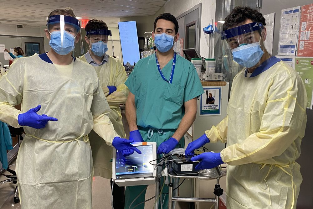 From left, Drew Copeland, RPSGT; Dr. Thomas Tolbert; Dr. Brian Mayrsohn, and Dr. Hooman Poor stand with a ventilator prototype they developed from a sleep apnea machine at Mount Sinai hospital in New York.