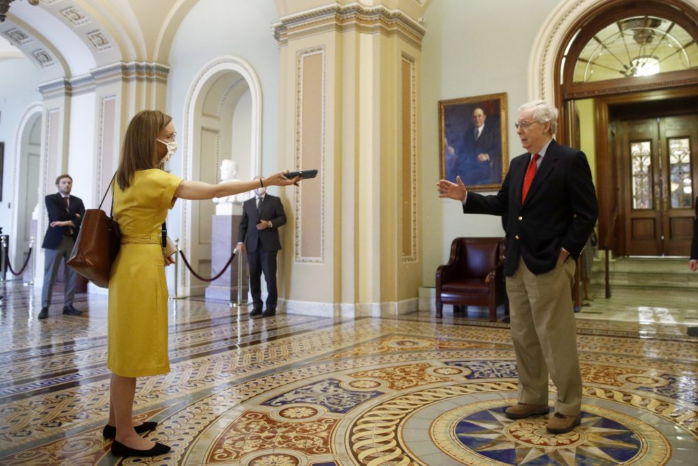 Senate Majority Leader Mitch McConnell of Kentucky speaks with a reporter outside the Senate chamber on Capitol Hill in Washington on Thursday.