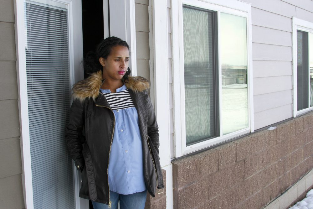 Kulule Amosa steps out of the apartment she shares with her husband who works at the Smithfield Foods pork processing plant in Sioux Falls, S.D. He tested positive for the coronavirus this week after an outbreak at the plant.