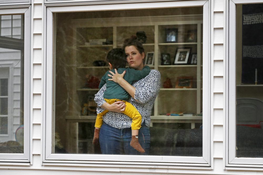 Joy Engel holds her son Wednesday at her home in Cape Elizabeth. Engel, who is pregnant, and her husband, Dr. Ben Hagopian, who works at a family practice and an urgent care clinic, decided to isolate themselves from each since the coronavirus outbreak.