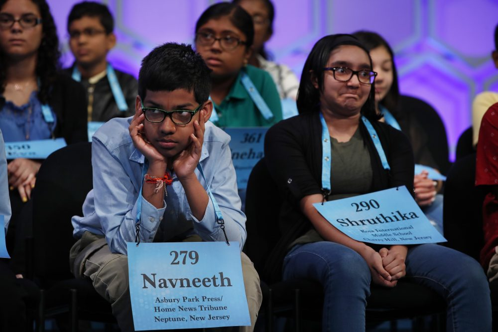 Navneeth Murali, 12, of Edison, N.J., left, and Shruthika Padhy, 12, of Cherry Hill, N.J., react during the Scripps National Spelling Bee on May 31, 2018, in Oxon Hill, Md.,  With the 2020 Scripps National Spelling Bee canceled because the coronavirus pandemic, an online spelling bee launched by two Texas teenagers is offering a consolation prize of sorts, with competitors nationwide including many of the kids who were considered favorites for the Scripps title.
