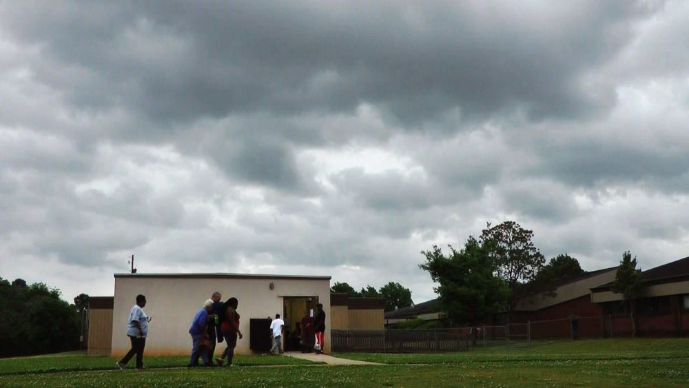 People enter a community storm shelter during a tornado watch April 29, 2014, in Tuscaloosa, Ala.