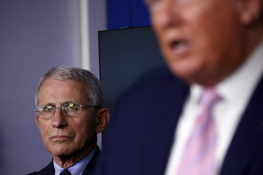 Dr. Anthony Fauci, director of the National Institute of Allergy and Infectious Diseases, listens as President Donald Trump speaks about the coronavirus in the James Brady Press Briefing Room of the White House, Wednesday, April 1.