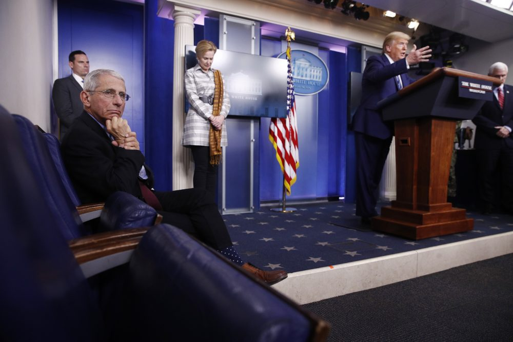 Dr. Anthony Fauci, director of the National Institute of Allergy and Infectious Diseases, left, listens as President Trump speaks during a coronavirus task force briefing at the White House in April in Washington. From left, Fauci, Dr. Deborah Birx, White House coronavirus response coordinator, Trump and Vice President Mike Pence. Pence said Tuesday that the task force could disband by early June, but no decision has been made.