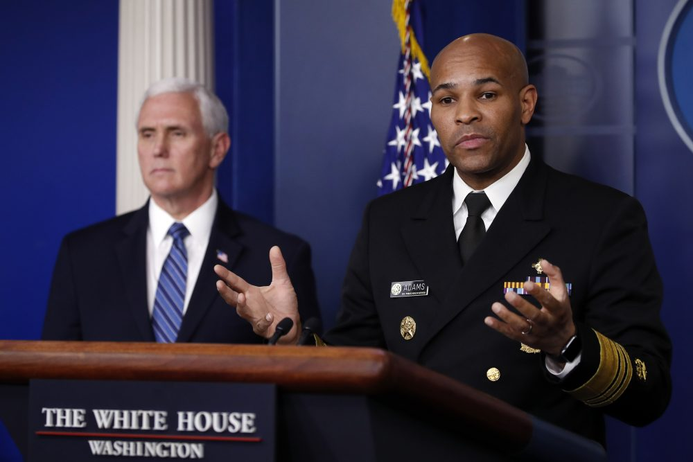 U.S. Surgeon General Jerome Adams speaks about the coronavirus in the James Brady Press Briefing Room of the White House on Friday in Washington, as Vice President Mike Pence listens.