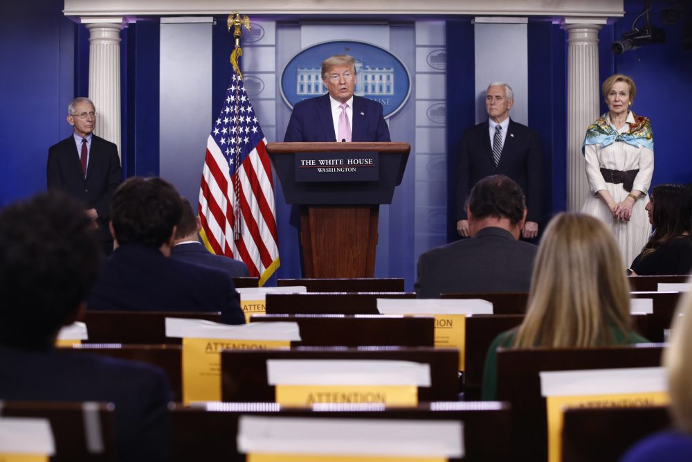 President Trump speaks during a coronavirus task force briefing at the White House on Saturday in Washington. From left, Dr. Anthony Fauci, director of the National Institute of Allergy and Infectious Diseases, Trump, Vice President Mike Pence and Dr. Deborah Birx, White House coronavirus response coordinator.