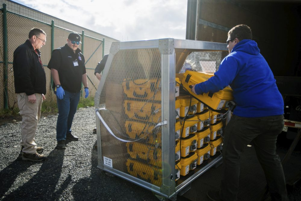 Officials at the Yakima Valley Office of Emergency Management evaluate how many ventilators arrived from the weekly supply shipment Thursday in Union Gap, Wash.