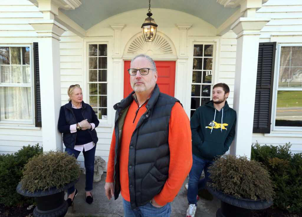 Liz and Ken Frydman and their son Beau stand in front of their country home in Sharon, Conn. They left their Manhattan apartment as the coronavirus ravaged New York and are staying in Connecticut full time.