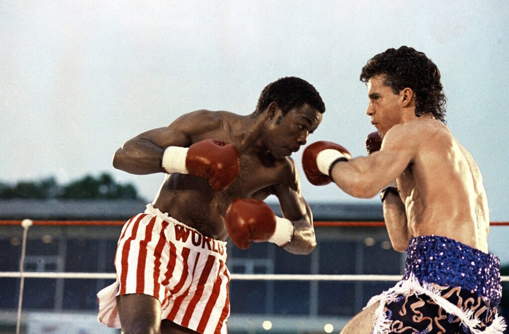Jerry NGobeni, left, of South Africa, and Joey Gamache, of Lewiston, trade punches during the WBA Junior Lightweight Championship title fight, Friday, June 28, 199 in, Lewiston. Gamache, 25, won after knocking NGobeni down twice in the 10th round.