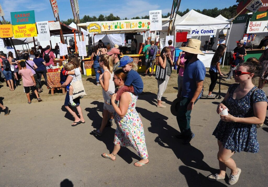 Fair goers line the walkway during the Common Ground Country Fair in Unity last year.