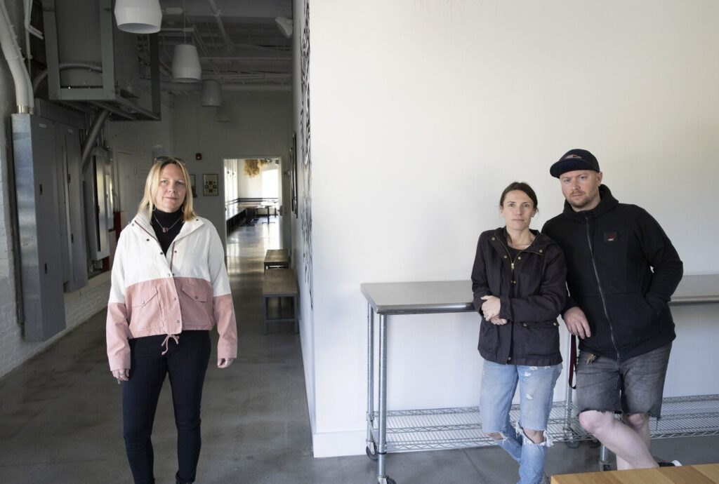 Carrie Blakeman, left, of Rogers Collection in Yarmouth and Christian and Christine Hayes, owners of The Garrison restaurant and Dandelion Catering. Blakeman has been working with local businesses that have been hit with a 25 percent tariff, trying to get the tariff lifted during the pandemic.