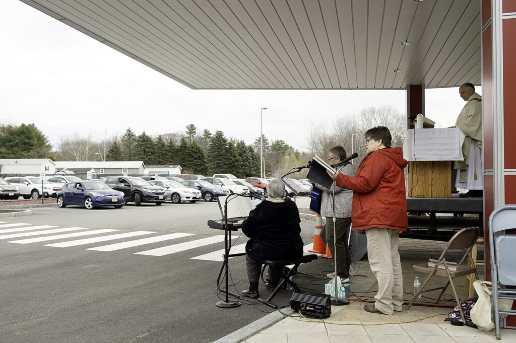 Sister Monique Belanger, left, Anne Marie Gagnon and Joline Laliberte play hymns during the Prince of Peace Parish parking lot mass at Geiger in Lewiston on Sunday.