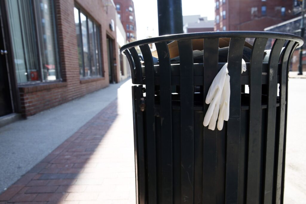 A protective glove clings to a trash barrel on Congress Street in Portland.