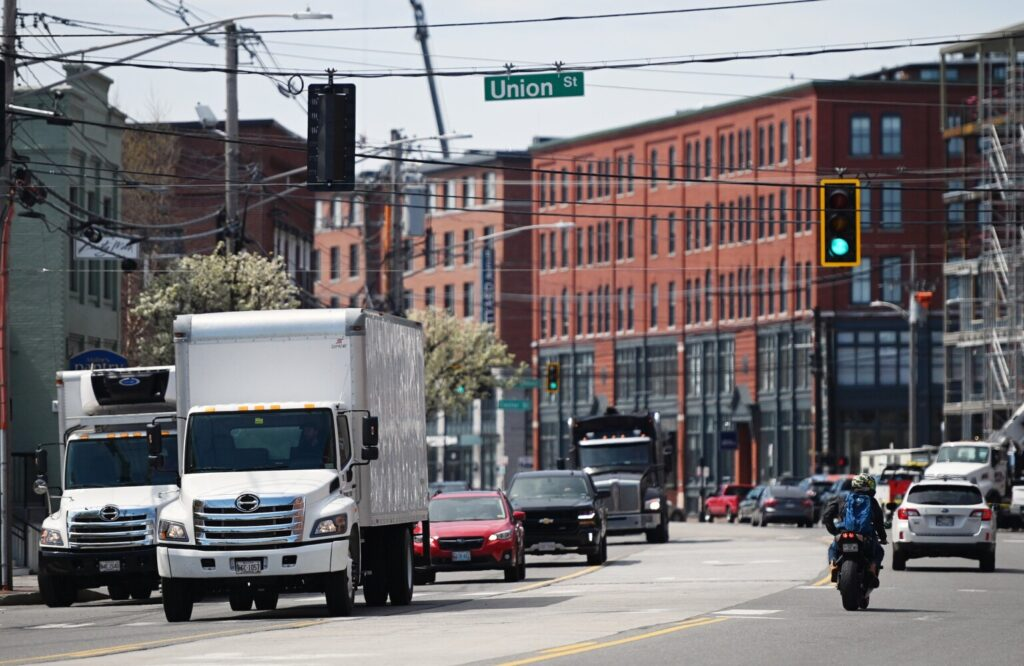 Traffic moves along Commercial Street in Portland at its intersection with Union Street on Monday. Mobility is still way down in Maine since the coronavirus pandemic struck, but Mainers have begun to move around more as statewide business restrictions have eased.