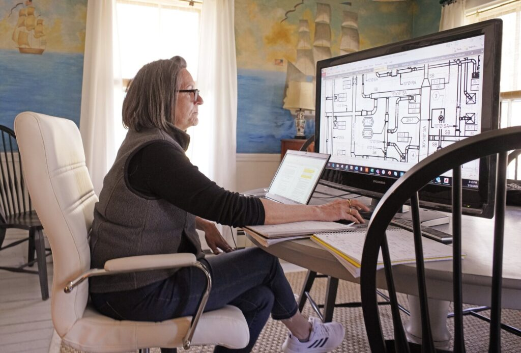 Kate Everett, director of operations for SMRT, works from her home office in Kennebunk on May 13. Many working remotely in Maine are enjoying their time at home, and some employers say staff are more engaged and productive.