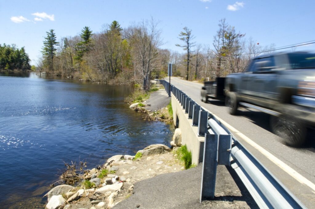 The bridge and the informal hand-carry boat launch, top center, into Lower Togus Pond, seen May 13, 2020 on the south side of Route 105 in Augusta. The shoulder of road on both sides of bridge between the ponds is a popular spot to park vehicles to fish or launch boats.