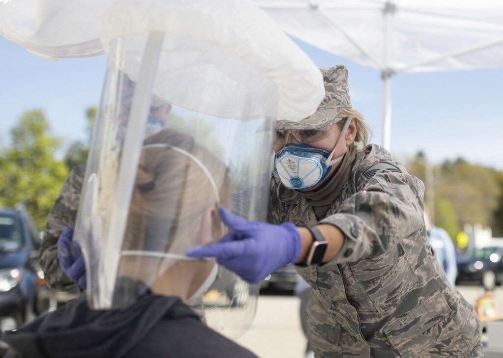 Air National Guard Master Sgt. Mary Pelletier helps a Gorham House staff member in a fit testing for personal protective equipment in the parking lot of the assisted living facility on May 19. National Guard members have been traveling around the state to congregate care facilities, fit testing and training workers for personal protective equipment.