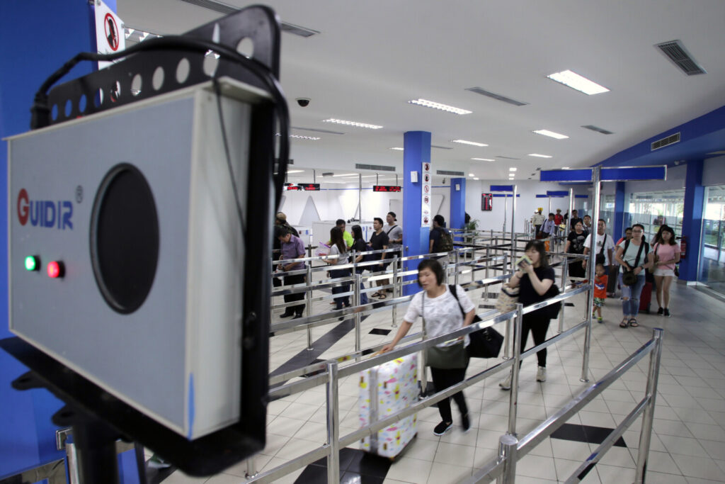 A thermal scanner is installed to scan the body temperature of passengers arriving in Batam, Indonesia, in 2016 as officials tried to detect passengers infected with the Zika virus.  Some small businesses and public officials are now spending heavily on the cameras without understanding their limitations – namely, that they're not very good at actually detecting coronavirus infections.