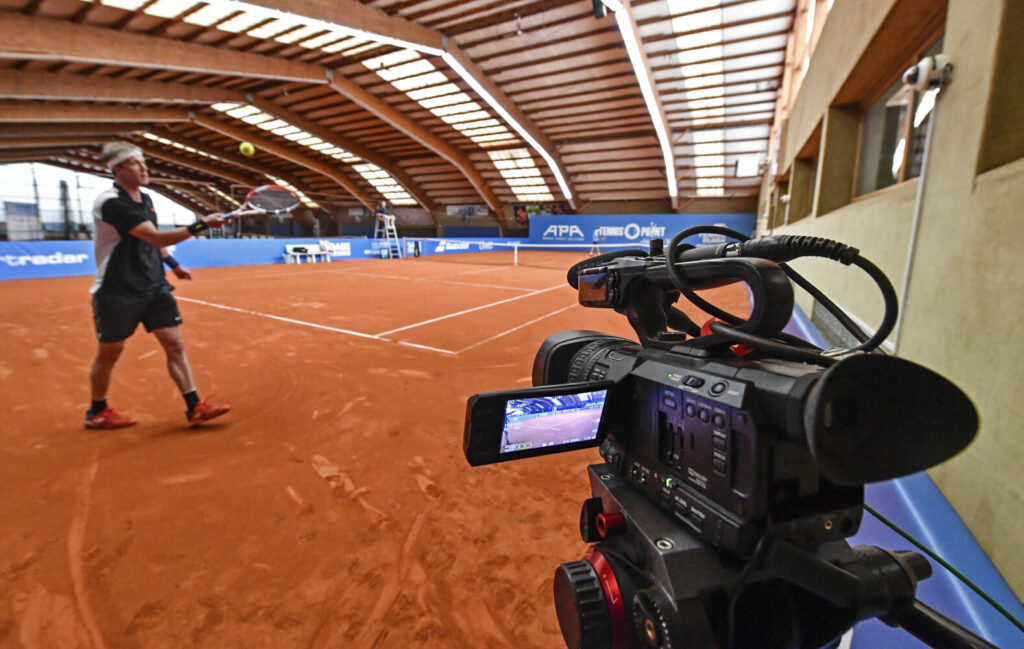 A camera is filming a match during a pro-tennis tournament at a tennis academy in Hoehr-Grenzhausen, western Germany on Friday. The professional tennis exhibition in the small village in the Westerwald is a rare exception to the global shutdown of sports during the coronavirus pandemic.