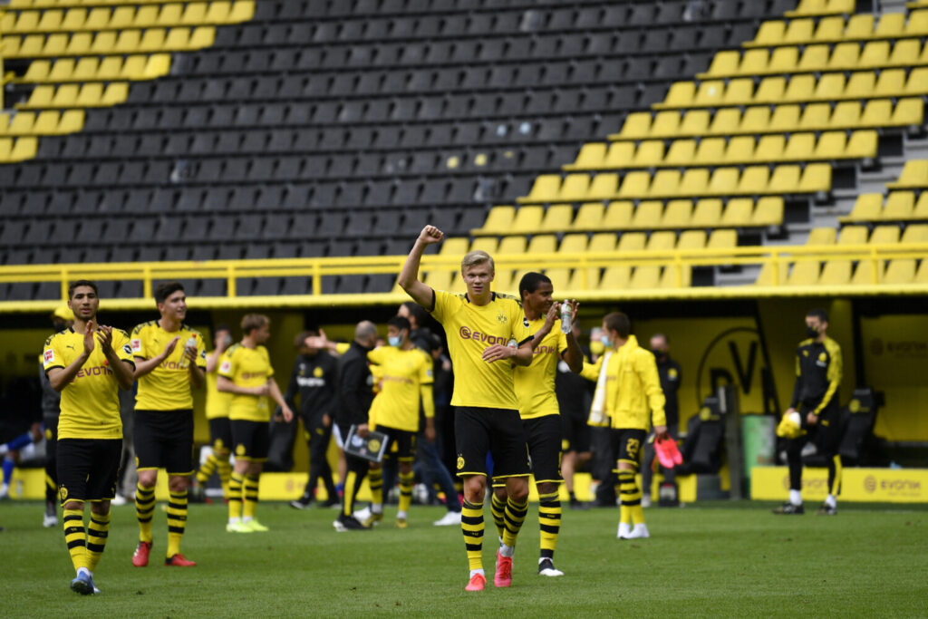 Dortmund's Erling Haaland, center, and his teammates celebrate at the end of the German Bundesliga soccer match between Borussia Dortmund and Schalke 04 on Saturday in Dortmund, Germany. The German Bundesliga becomes the world's first major soccer league to resume after a two-month suspension because of the coronavirus pandemic. Dortmund won 4-0.