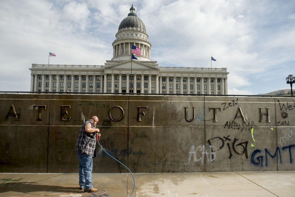 Don Gamble cleans up graffiti at the Capitol in Salt Lake City on Sunday, following protests over the death of George Floyd. Protests were held throughout the country over the death of Floyd, a black man who died after being restrained by Minneapolis police officers on May 25.
