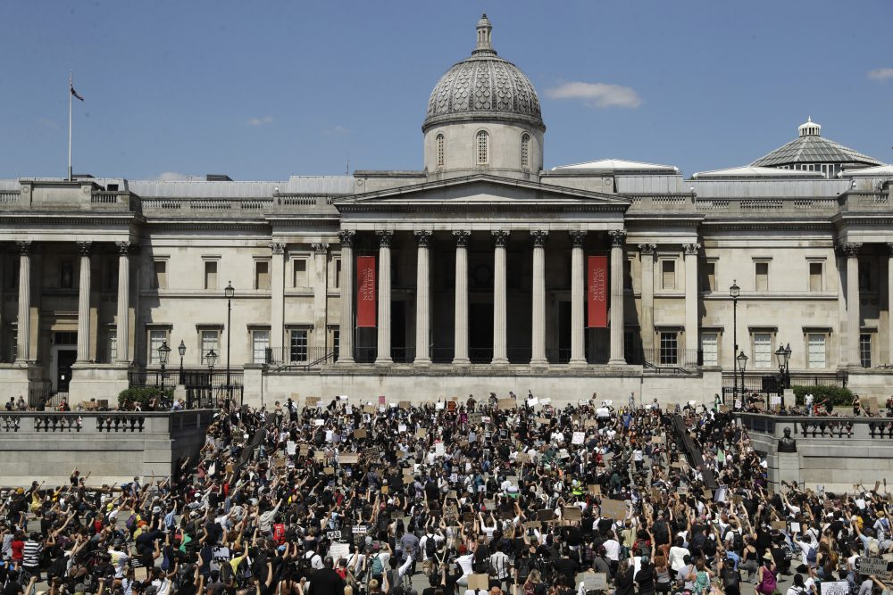People, some of them kneeling gather in Trafalgar Square in London on Sunday to protest against the recent killing of George Floyd by police officers in Minneapolis. Many demonstrators were not wearing masks and most in the crowd were packed closely together. Britain has seen nearly 38,500 virus deaths, the second-highest in the world after the United States.